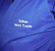 Embroidery of name on suit