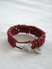 Flätat armband med litet hjärta i tenn rosa