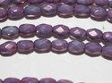 Ovala fasetter i metallic lila, 6*4 mm. Ca 12 cm sträng.