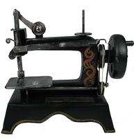 Gammaldags symaskin typ antik leksak i metall shabby chic lantlig stil