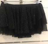 Svart rynkad kjol med massor av glitter