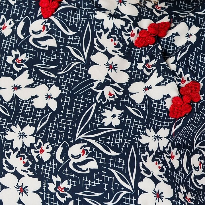adf552daf77f emmy design - the beach beauty playsuit. navy floral