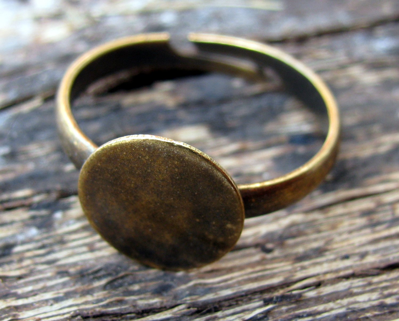 Smyckesdelar Ringstommar Ringstomme Bronsfärgad - Platta 10mm 1 styck.  Previous. Next. Previous fdaa28ac8e856