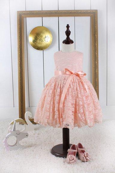 Aprikosen Prinzessin Kleid aus Spitze mit Schleife